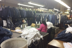 Stack Of Industrial Workwear Clothes In West New York, NJ Image  - Prime Uniform Supply